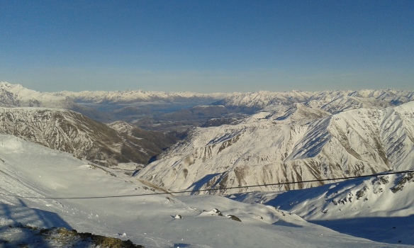 A photo taken during the conference excursion from the top of Cadrona ski field looking back toward Queenstown