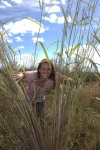 Vanessa Adams in the field with gamba grass in the Batchelor region, NT. ©Amy Kimber (NERP Northern Australia Hub)