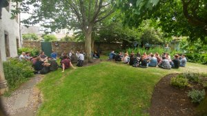 Group discussions taking place in the garden at BES Macro 2018. © Tom August